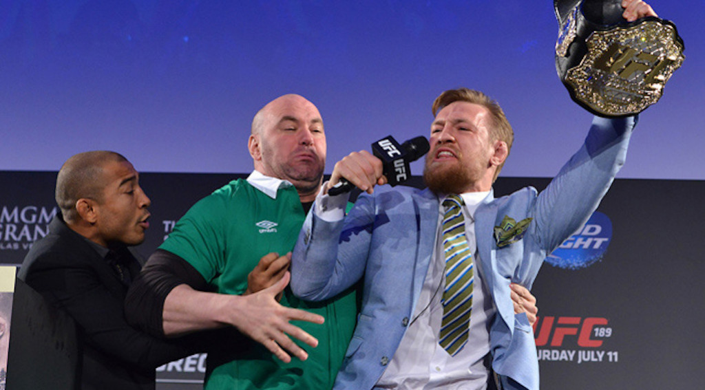 conor-mcgregor-jose-aldo-belt-snatch
